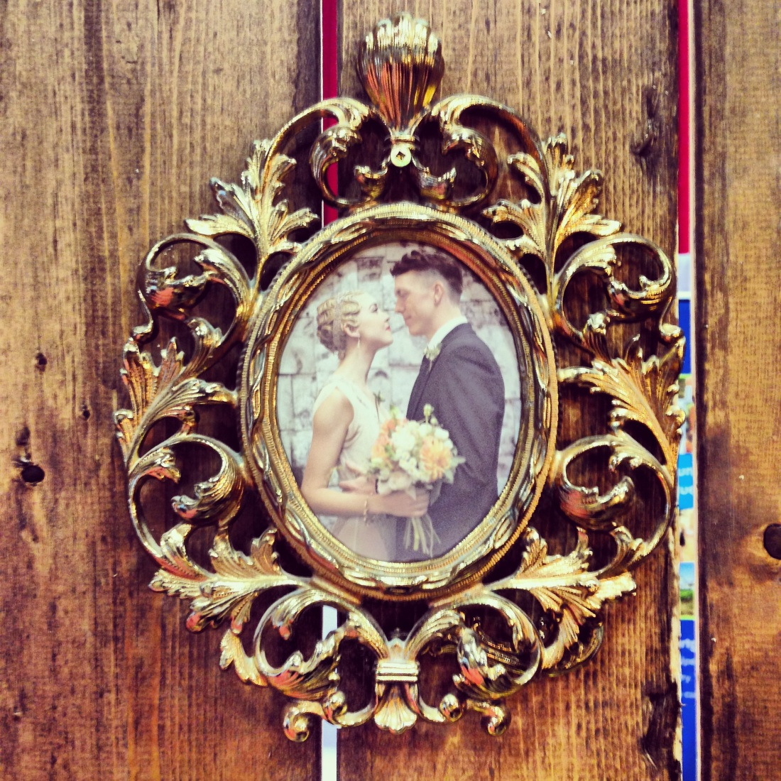 brass vintage frame with wedding photo